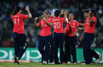 Katherine Brunt of England is congratulated, after she caught Sana Mir, Captain of Pakistan off the bowling of Laura Marsh