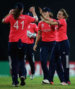 Laura Marsh of England is congratulated on the wicket of Muneeba Ali of Pakistan, after she was caught by Katherine Brunt of England
