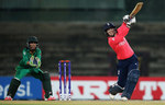 Tammy Beaumont of England hits the ball toward sthe bounadry