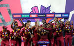 The West Indies team celebrate with the trophy after winning the Women's ICC World Twenty20 India 2016 Final