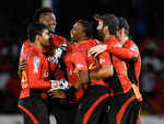 Knight Riders celebrate after getting a crucial wicket