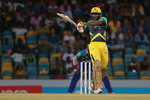 Chris Gayle heaves one to mid-wicket