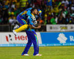 Ravi Rampaul celebrates as the keeper embraces him