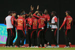 The Knight Riders celebrate after striking