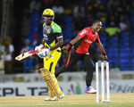 DJ Bravo celebrates after taking a wicket