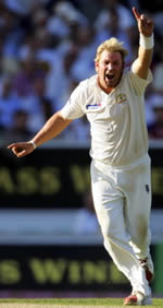 Shane Warne celebrates the wicket of Andrew Strauss