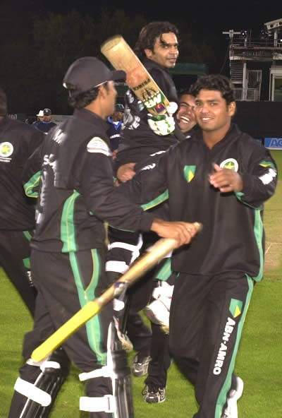 Faisalabad Wolves players lift Naved Latif (45*)