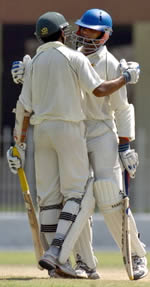 Mansoor Amjad (L): celebrates his fifty during his innings of 82 against Australia A, 20 Sept 2005