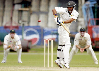 Imran Farhat turns a ball