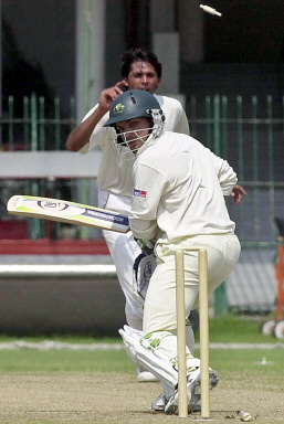 Chris Hartley playing-on to Mohammad Asif