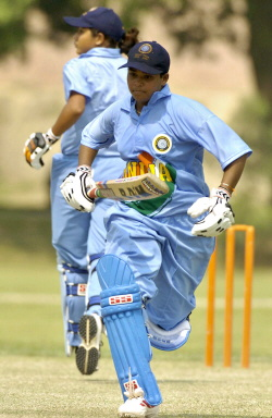 Shweta Jadhav (R) and Anagha Deshpande run between wickets