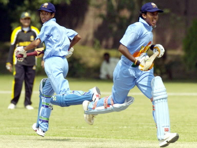 Diana David (L) and Anagha Deshpande (R) run between wickets