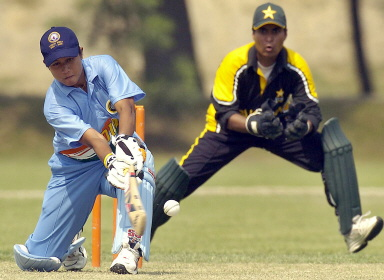 Shweta Jadhav (L) plays a sweep