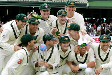 Stuart MacGill and Ricky Ponting as other team members celebrate their win over the World XI