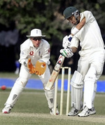 Hasan Raza (R) plays a shot as England wicketkeeper Geraint Jones (L) looks on