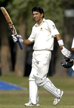 Hasan Raza celebrates after he scored a half century