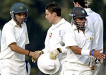 Hasan Raza (L) shake hands with Geraint Jones