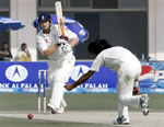 Andrew Flintoff drives a ball Mohammad Sami at Multan Cricket Stadium