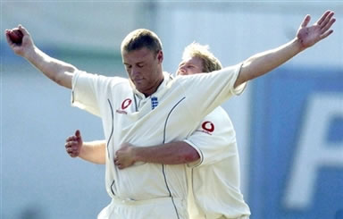 Andrew Flintoff celebrates after taking a catch