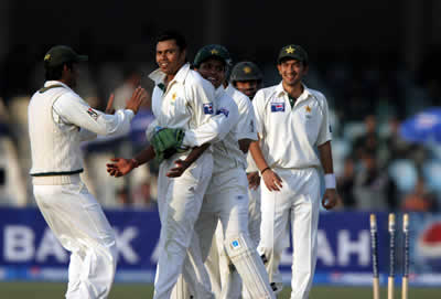 Danish Kaneria celebrates after taking a wicket