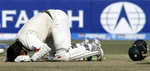 Mohammad Yousuf kneels down after completing his century