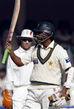 Mohammad Yousuf celebrates after his century