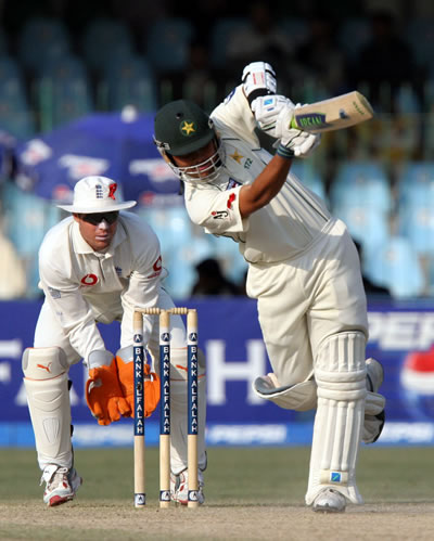 Kamran Akmal drives a ball
