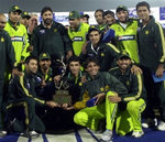 Pakistani cricketers with the series trophy