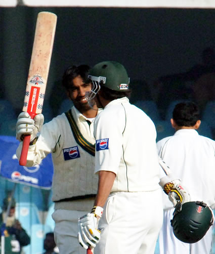 Mohammad Yousuf raises his bat after his 100