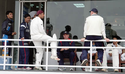 Indian coach and players sitting outside the dressing room after play stop