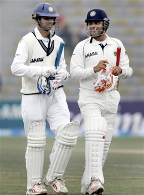 Rahul Dravid and Virender Sehwag leaves the ground after bad light