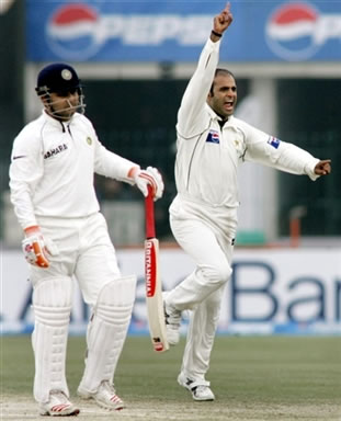 Naved-ul-Hasan celebrates after taking a wicket