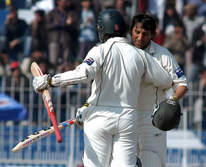 Younis Khan congratulates by teammate after his century
