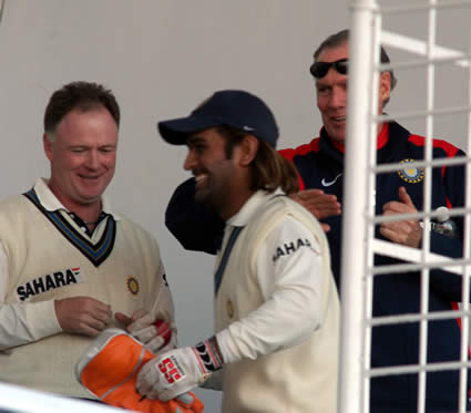 Chappel and Freser congratulate to Dhoni