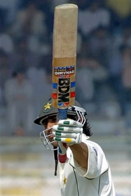 Younis Khan raises his bat to the crowd