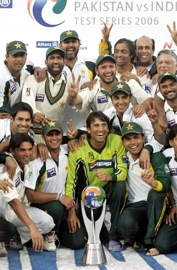 Pakistan players pose with the winning trophy