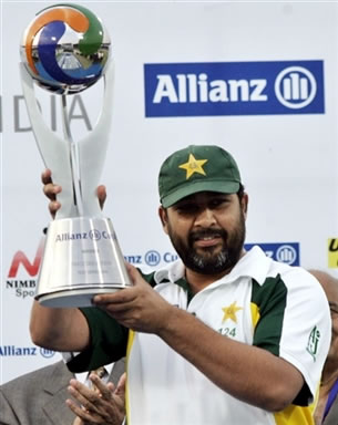Inzamam-ul-Haq holds the winning trophy
