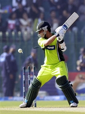 Kamran Akmal is bowled out