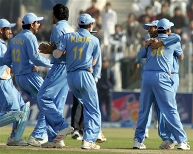Indian cricketers celebrates after taking a wicket