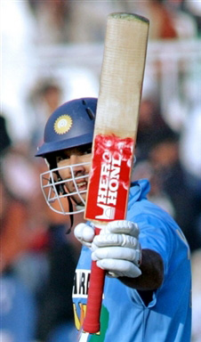 Yuvraj Singh waves his bat after his 50