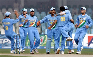 Indian players celebrates the dismissal of Salman Butt