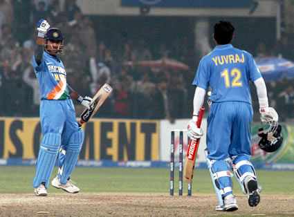 Mahendra Dhoni congratulates after victory