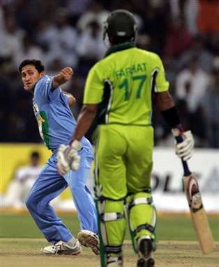 Ajit Agarkar celebrates the dismissal of Imran Farhat
