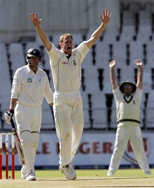 Pollock celebrates after the dismissal of Oram