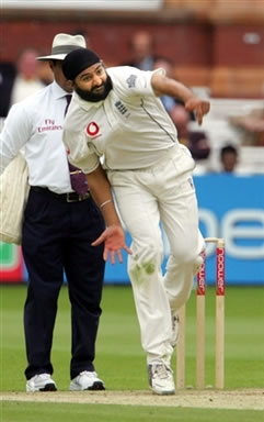 Panesar delivers a ball