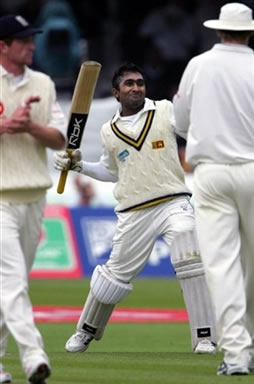 Jayawardene celebrates after his century