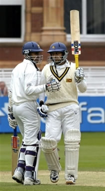 Dilshan celebrates his fifty