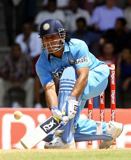 Dhoni plays a sweeps shot