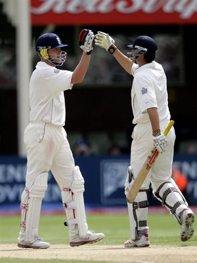 Flintoff celebrates with Cook after their victory