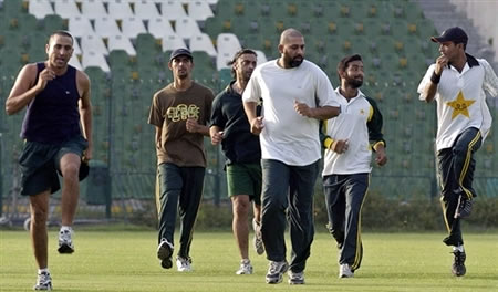 Inzamam-ul-Haq warms up with team players during a conditioning camp
